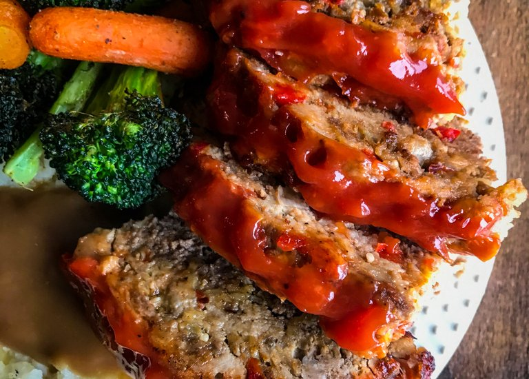 The Best Meatloaf on plate with vegetables