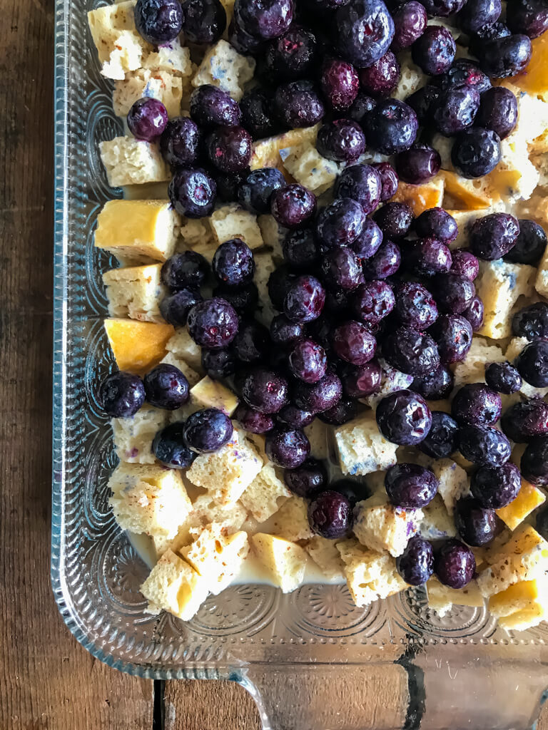 Blueberry French Toast Bake with pile of blueberries on top