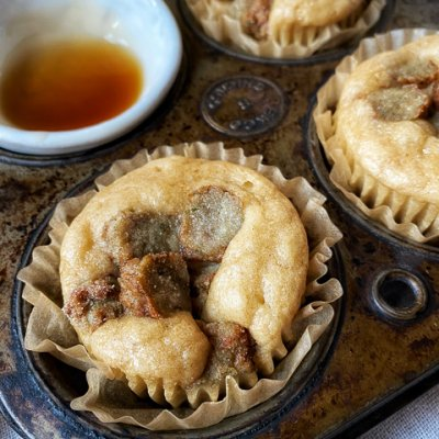 sausage pancake muffins in a tin with syrup in a bowl