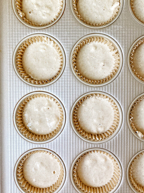 muffin tin with batter in cupcake liners