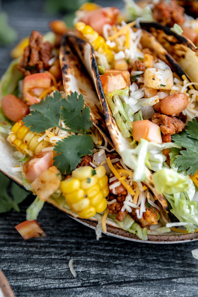 cowboy's meal tacos on plate with gray background