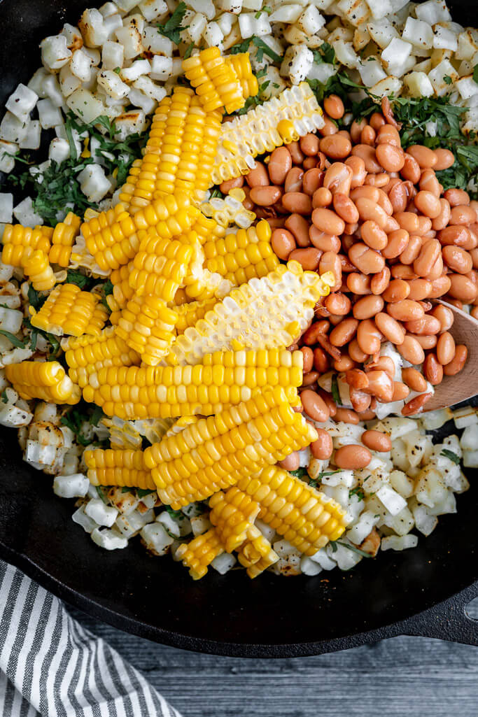 skillet with pinto beans and fresh corn