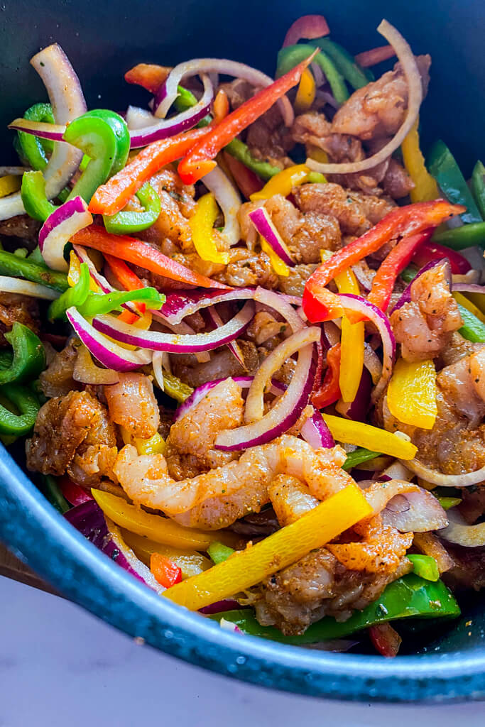 raw chicken, air fryer, and peppers and onions