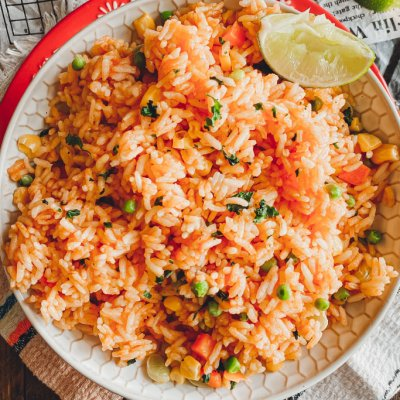 Instant Pot Mexican Rice in bowl with linmes on the side