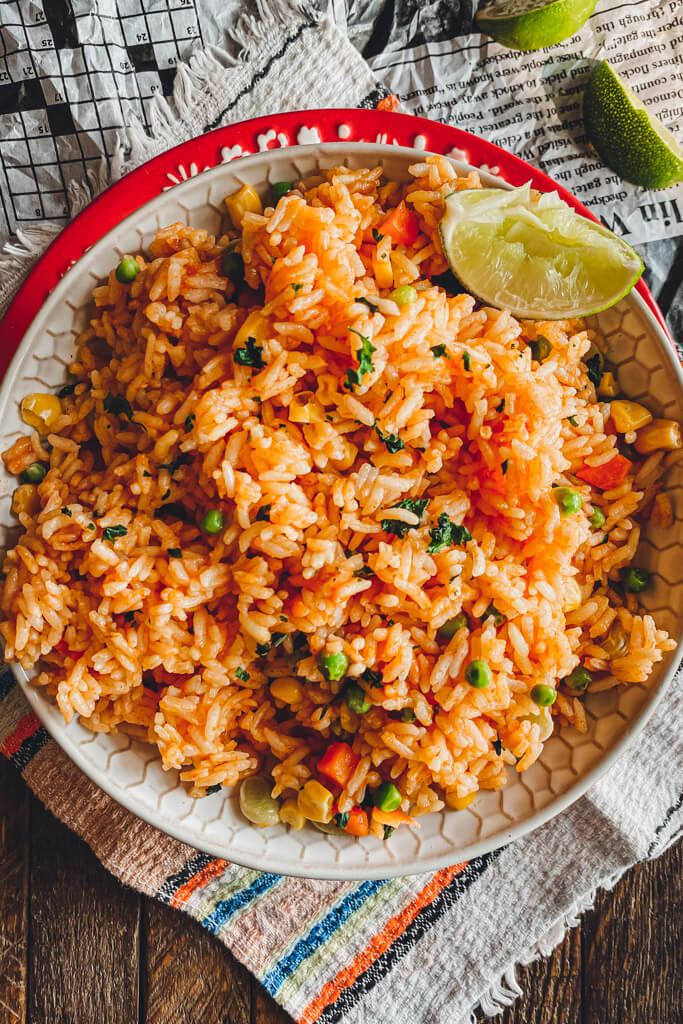 instant pot Mexican Rice in a white bowl with lime on the side